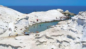 via: https://upload.wikimedia.org/wikipedia/commons/f/fb/Sarakiniko_white_beach.jpg